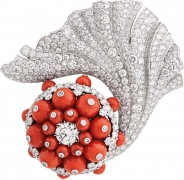 Erythros clip. White gold, round diamonds and coral beads.