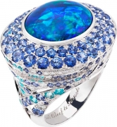 ILE AU TRESOR ring. White gold, round diamonds, round sapphires, round Paraiba-like tourmalines, one cabochon-cut opal of 13.22 cts.
